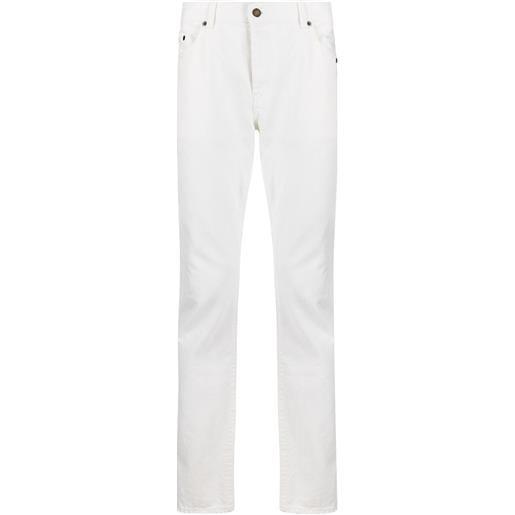 Saint Laurent jeans slim con effetto schiarito - bianco